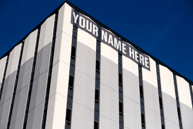 """Large Office Building With """"Your Name Here"""" Sign"""