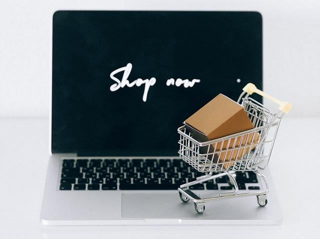 Mini Shopping Cart On Top of Laptop