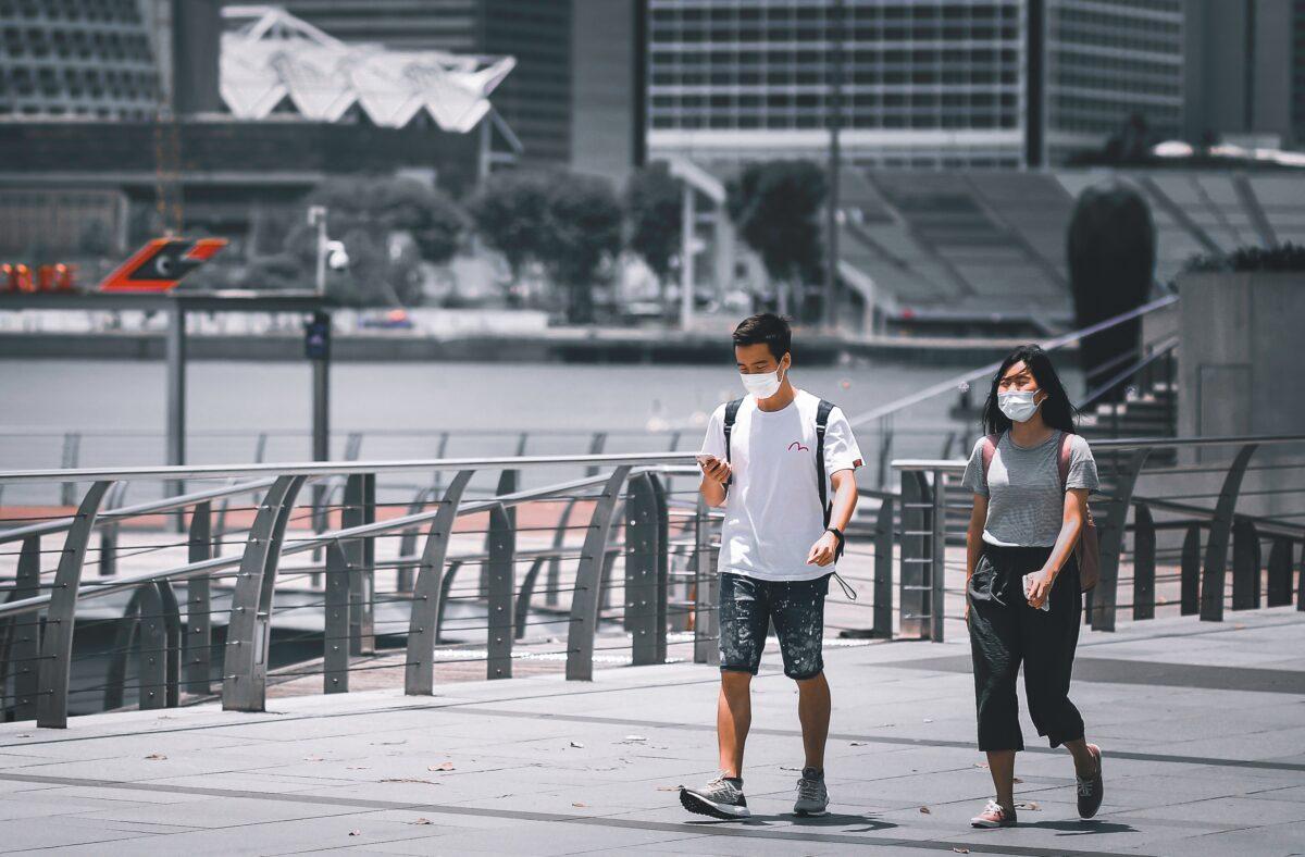 Two people walking along Marina Bay in Singapore